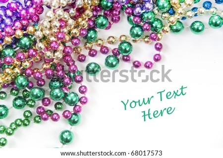 holiday or mardi gras beads - stock photo