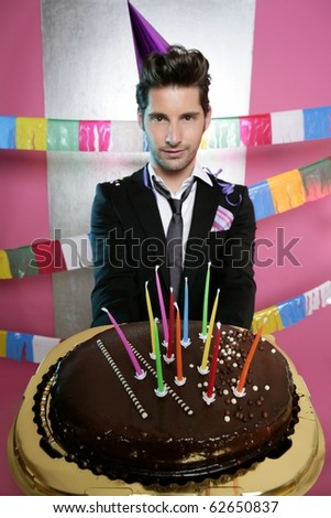 Holiday party chocolate cake in young man hands focus on foreground - stock photo