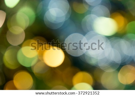 Holiday party defocused lights green and gold color. - stock photo