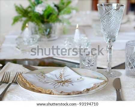 Holiday place setting with candles - stock photo