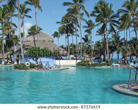 holiday resort with big pool at the Dominican Republic, a island of Hispanola wich is a part of the Greater Antilles archipelago in the Carribean region - stock photo