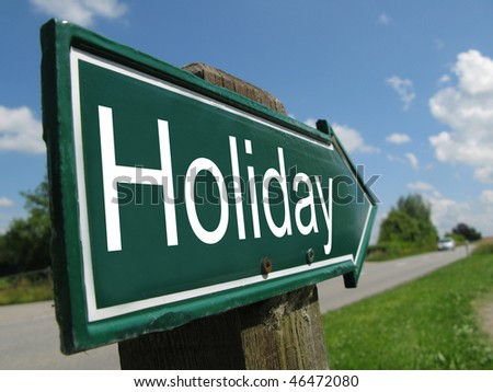 HOLIDAY road sign