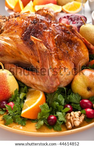 holiday roasted turkey garnished with sourdough stuffing and fruit - stock photo