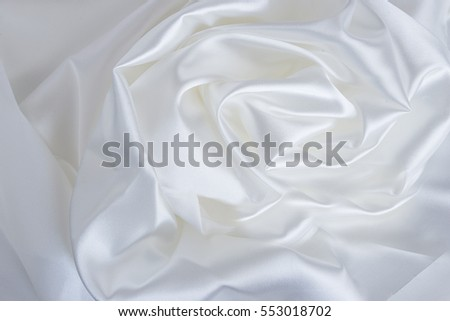 holiday's background/White satin shaped rose flower