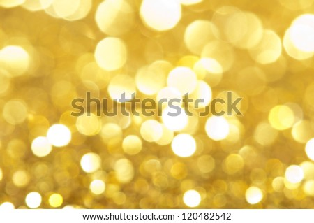 Holiday shiny blurry lights in yellow colors - stock photo