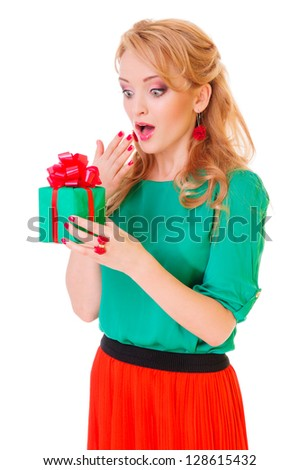 holiday. surprised blonde woman holding  gift box. positive portrait isolated