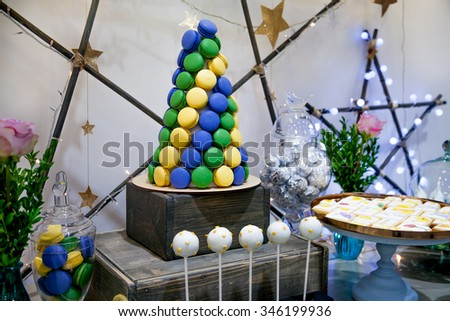 Holiday sweet table or candy bar decorated with stars - stock photo