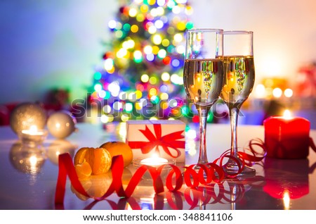 holiday table glasses of champagne on the background of Christmas tree