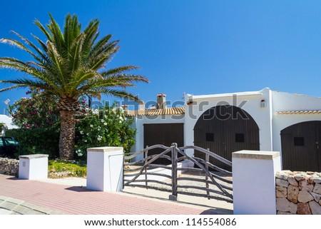 Holiday villa Menorca Mediterranean blue sky - stock photo