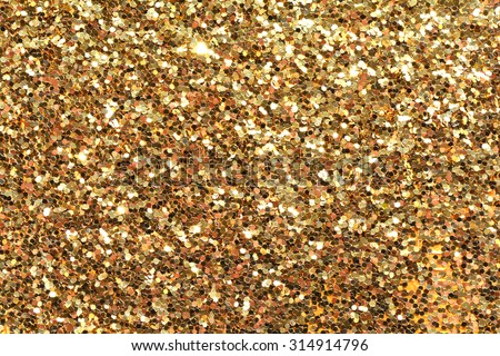 Holiday yellow glitter, gold sand and dust texture. Golden sparkling background. Orange brown metallic surface.  - stock photo