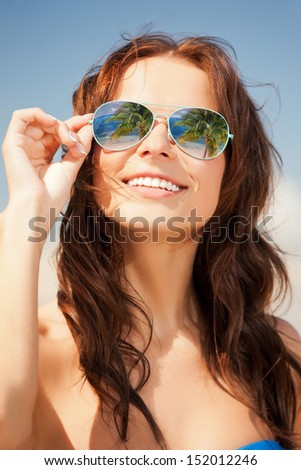 holidays and beach concept - beautiful woman in bikini and sunglasses - stock photo