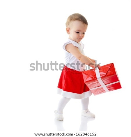 Holidays, baby girl dancing with presents, christmas, birthday, new year, x-mas concept - happy child girl with gift boxes  - stock photo