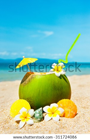 Holidays Background. Ocean beach with palm and and coctail