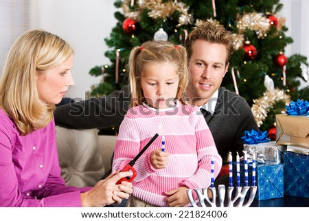 Holidays: Family Celebrates Hanukkah And Christmas Together - stock photo