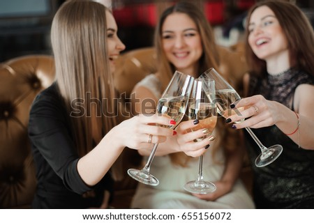 holidays, nightlife, bachelorette party and people concept - smiling women with champagne glasses