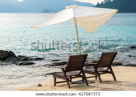 Holidays on the beach, beach chairs on the beach in the morning - stock photo