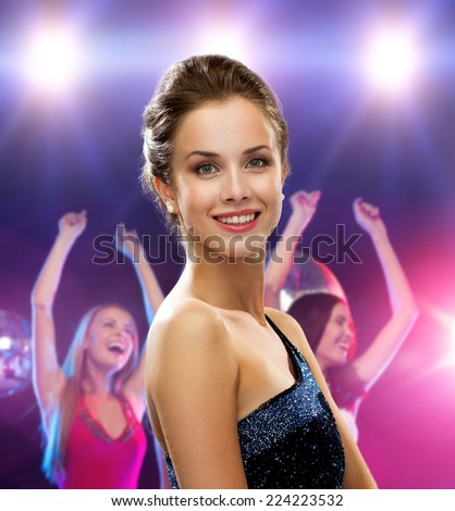 holidays, party and people concept - smiling woman in evening dress over disco background - stock photo