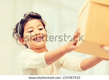 holidays, presents, christmas, birthday concept - happy child girl with gift box - stock photo