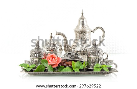 Holidays tea table setting with mint leaves and rose flower. Ramadan karim. Oriental hospitality concept - stock photo