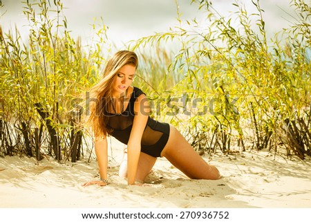 Holidays, vacation travel and freedom concept. Beautiful sexy girl on beach. Young pretty woman relaxing on the sea coast.