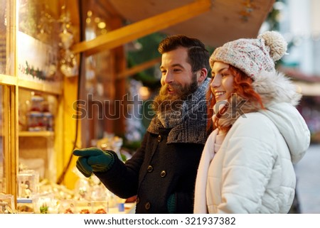 holidays, winter, christmas and people concept - happy couple in warm clothes outdoors - stock photo