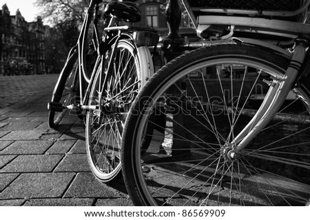 Holland, Amsterdam, bicycles parked by a bridge - stock photo