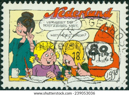HOLLAND - CIRCA 1998: A stamp printed in Netherlands shows Jan Jans cartoons and children, circa 1998 - stock photo