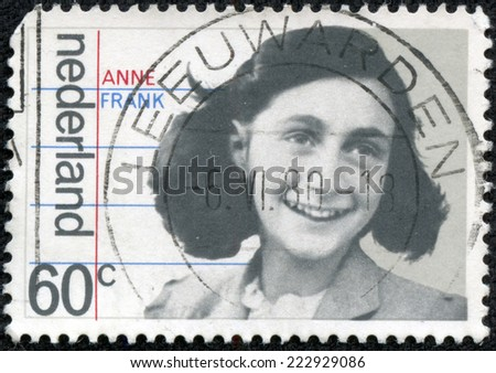 HOLLAND - CIRCA 1980: A stamp printed in The Netherlands shows image of Anne Frank, circa 1980 - stock photo