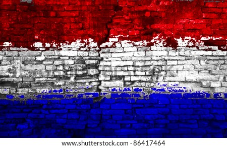 Holland flag painted on old brick wall - stock photo