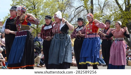 HOLLAND, MI - MAY 3: Tulip Time Festival dancers perform a mother-daughter dance in Holland, MI May 3, 2015.  - stock photo