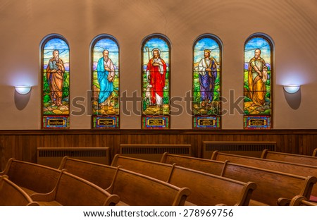 HOLLAND, MICHIGAN - MAY 12: Stained glass windows inside the Hope Church on May 12, 2015 in Holland, Michigan - stock photo