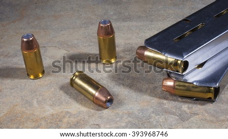 Hollow point ammunition and magazines for a semi automatic handgun - stock photo
