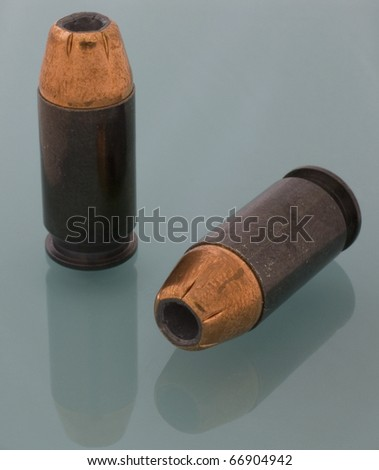 hollow point bullets for a 45 ACP handgun - stock photo