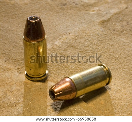 hollowpoint ammunition loaded and ready for use in a pistol - stock photo