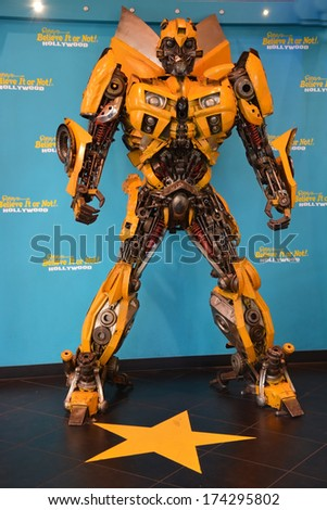 HOLLYWOOD - AUGUST 23: Bumble bee transformer on August 23, 2013 in Hollywood, California. Transformers is a famous Universal pictures film - stock photo