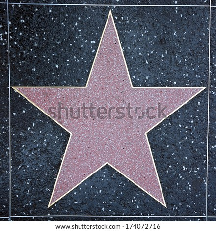 HOLLYWOOD - AUGUST 23: Empty star on Hollywood Walk of Fame on August 23, 2013 in Hollywood, California. This star is located on Hollywood Blvd. and is one of 2400 celebrity stars - stock photo