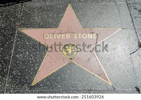 HOLLYWOOD - AUGUST 26, 2012: Oliver Stone's star on Hollywood Walk of Fame, as seen on August 26, 2012 in Hollywood in California. This star is one of 2400 celebrity stars located on Hollywood Blvd. - stock photo