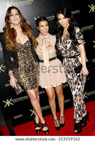 HOLLYWOOD, CA - AUGUST 17, 2011: Khloe Kardashian, Kourtney Kardashian and Kim Kardashian at the Kardashian Kollection Launch Party held at the Colony in Hollywood, USA on August 17, 2011. - stock photo