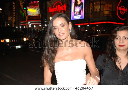 """HOLLYWOOD, CA- FEBRUARY 8: Actress Demi Moore arrives at the world premiere of the movie """"Valentine's Day"""" held at The Chinese Theater, February 8, 2010 in Hollywood, CA. - stock photo"""