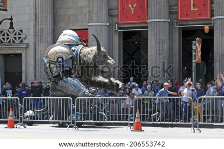 HOLLYWOOD, CA - JULY 22, 2014:  A mechanical beast prowls Hollywood Boulevard during taping of a special presentation to be shown at Comic-Con International in San Diego.