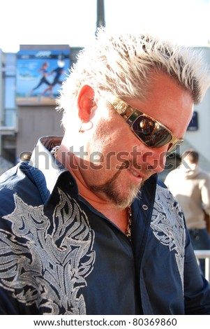 "HOLLYWOOD, CA- JUNE 18: Chef Guy Fieri attends the Disney's Pixar ""Cars 2"" premiere, held at El Capitan Theatre, June 18, 2011 in Hollywood,CA. - stock photo"