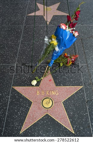 HOLLYWOOD, CA -MAY 16, 2015: Flowers left by fans on B.B.King's star on the Hollywood Walk of Fame memorialize the legendary blues musician on May 16, 2015 in Hollywood, California.