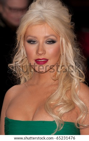 HOLLYWOOD, CA - NOVEMBER 15: Actress and singer Christina Aguilera arrives to the premiere of the movie Burlesque at the Grauman's Chinese Theater, on November 15, 2010 in Los Angeles, CA - stock photo