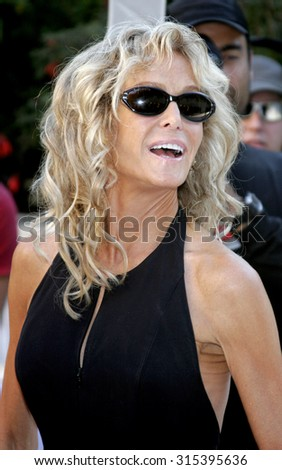 HOLLYWOOD, CA - OCTOBER 05, 2005: Farrah Fawcett at the remembering Rodney Dangerfield held at at the home of Joan Dangerfield in Hollywood, USA on October 5, 2005.