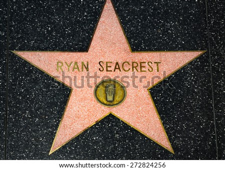 HOLLYWOOD, CA/USA - APRIL 18, 2015: Ryan Seacrest star on the Hollywood Walk of Fame. The Hollywood Walk of Fame is made up of brass stars embedded in the sidewalks on Hollywood Blvd. - stock photo