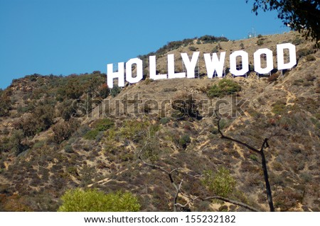 HOLLYWOOD, CA/USA - MARCH 17 2007: Hollywood sign celebratees its 90th anniversary in September 2013. Located on Mount Lee in Hollywood Hills in Los Angeles, its the worldwide symbol of entertainment - stock photo