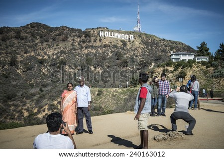 HOLLYWOOD, CALIFORNIA  DECEMBER 27: Tourists visiting the Hollywood Sign, built in 1923. This iconic landmark identifies The Entertainment Capital of the World, on December 27, 2014, in Hollywood.