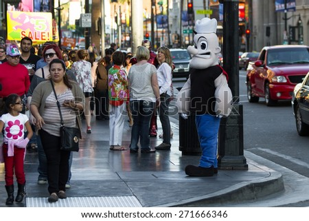 Hollywood, California - February 08 : Popeye on a street corner in Hollywood Blvd with crowds of people walking by, February 08 2015 in Hollywood, California.