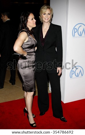 HOLLYWOOD, CALIFORNIA - January 22, 2010. Jane Lynch and Lara Embry at the 22nd Annual Producers Guild Awards held at the Beverly Hilton hotel, Los Angeles.   - stock photo