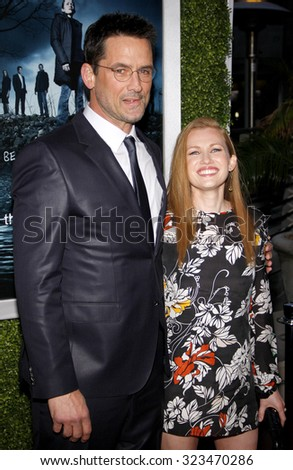 HOLLYWOOD, CALIFORNIA - March 26, 2012. Billy Campbell and Mireille Enos at the Los Angeles Season 2 premiere of AMC's 'The Killing' held at the ArcLight Cinemas in Hollywood. - stock photo